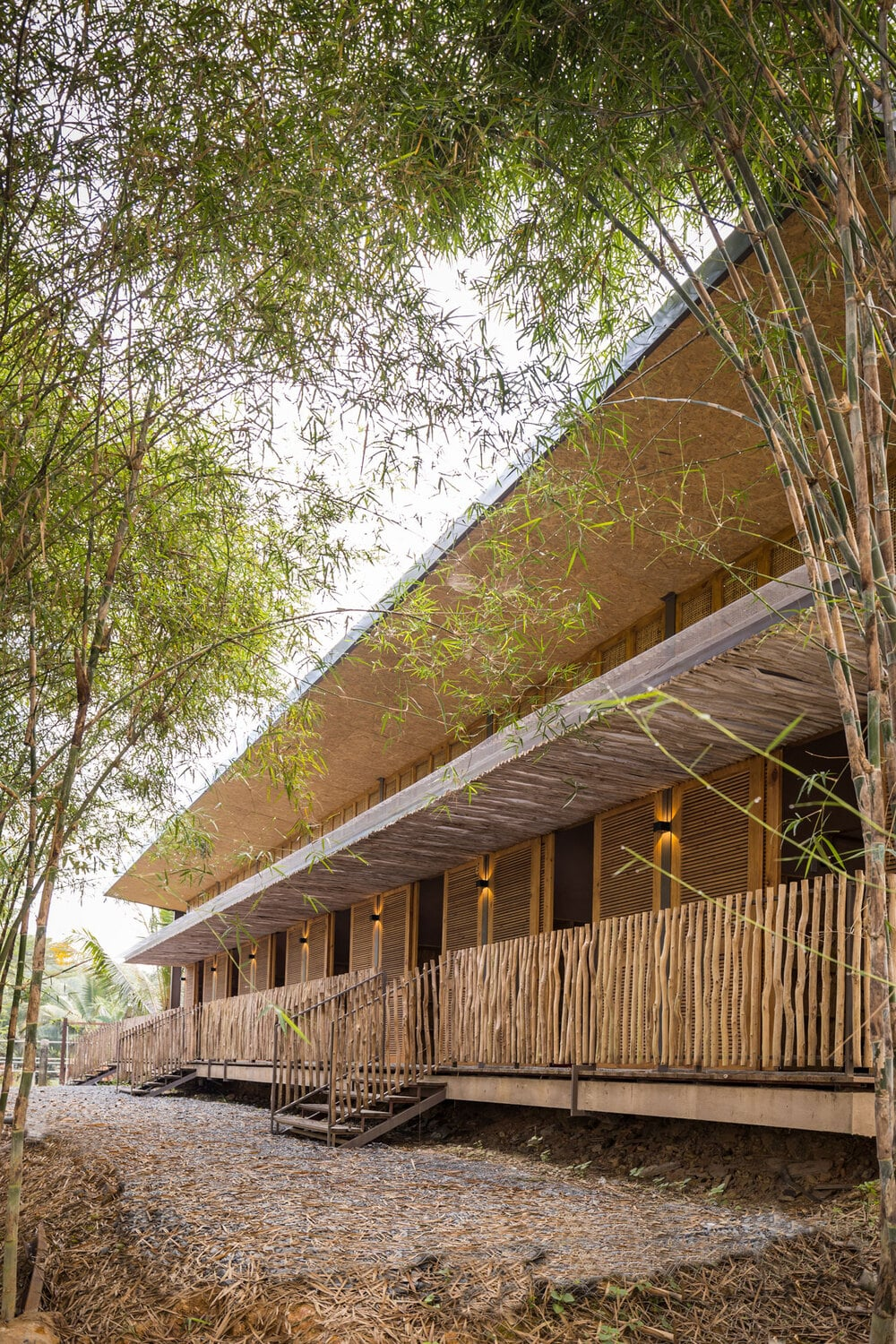 This is a look at the front of the dormitory with bamboo railings on the front porch.