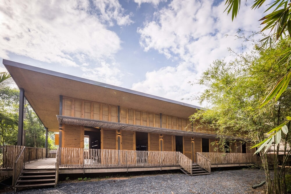 This front view of the dormitory showcases the bamboo accents of the exterior walls and railings of the porch walkway.