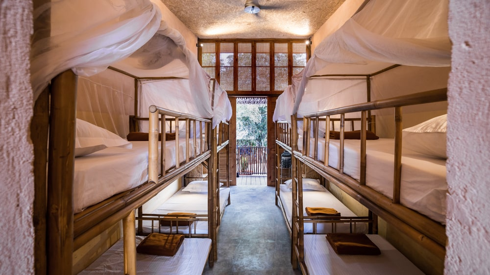 Each bunk bed is made of bamboo and has mosquito nets.