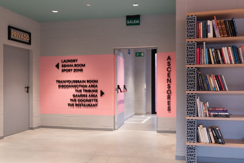 THis is a close look at one of the hallways with pink accent to the walls that make the labels and directions stand out.