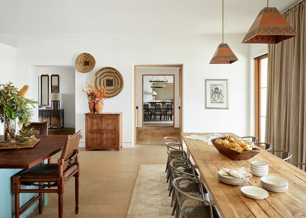 The kitchen also has a breakfast nook and informal dining area with a rustic rectangular wooden dining table paired with