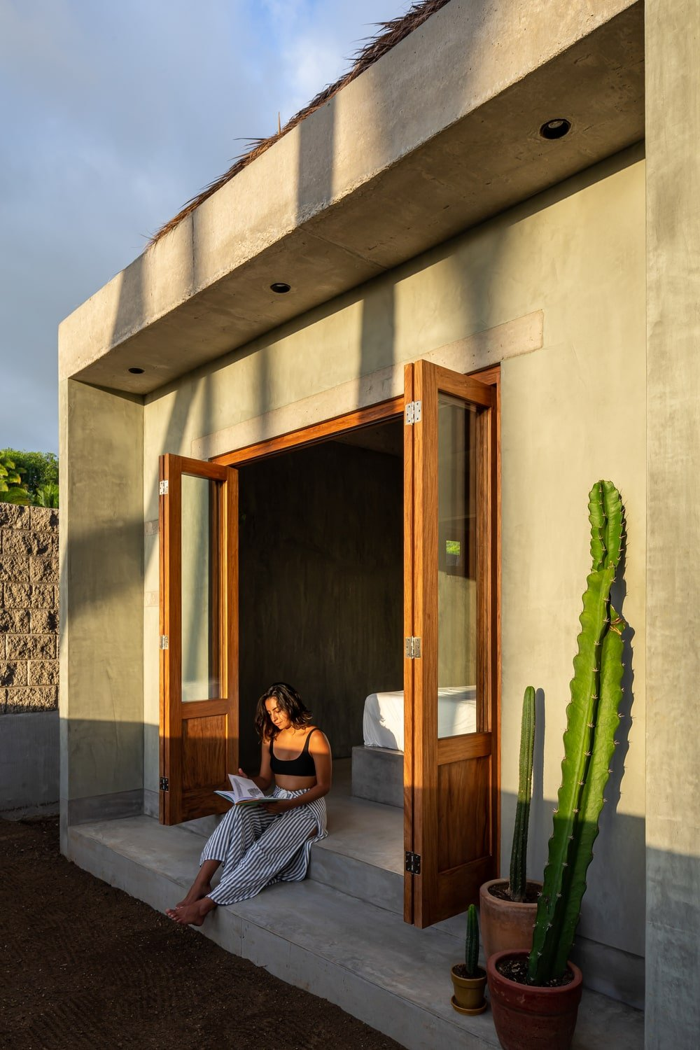 The side of the folding doors is adorned with a variety of cacti in pots.
