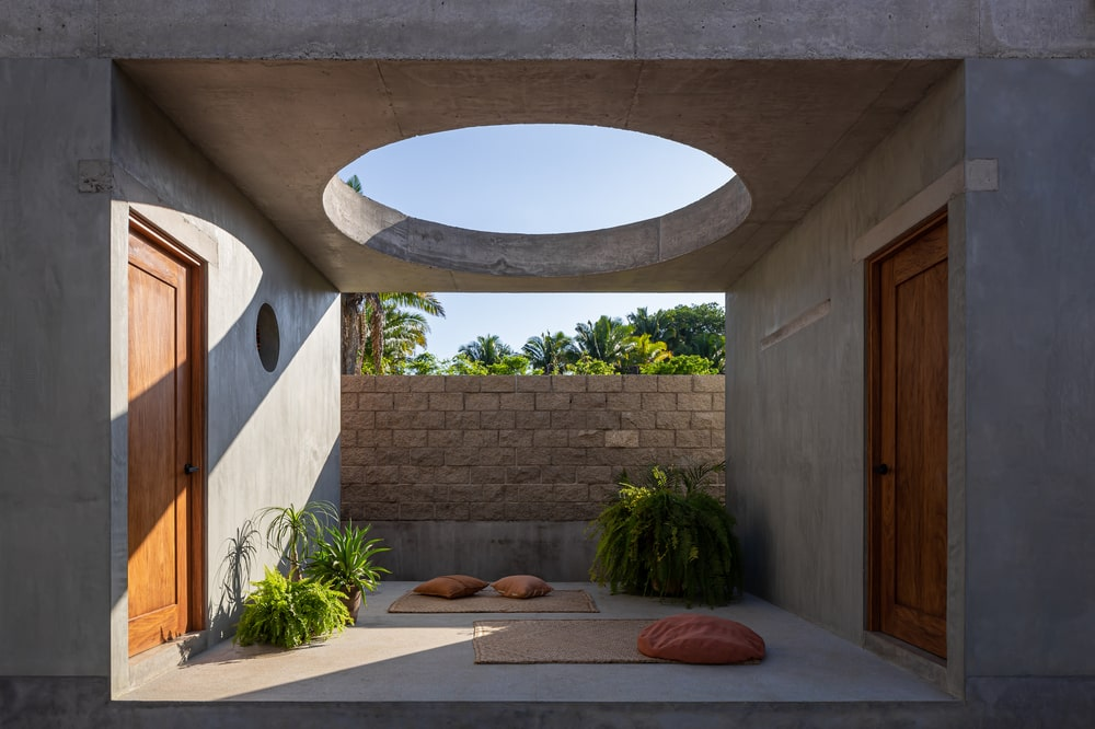 This is the open area in the middle of the two structures with a small zen garden topped with a round skylight.