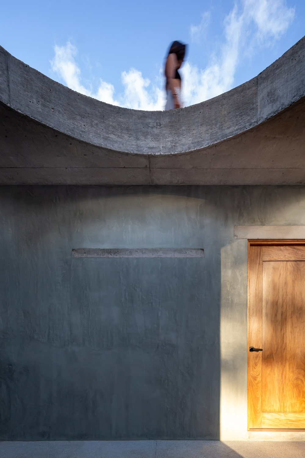 This is a close look at the concrete wall that pairs well with the wooden door of the bedroom.