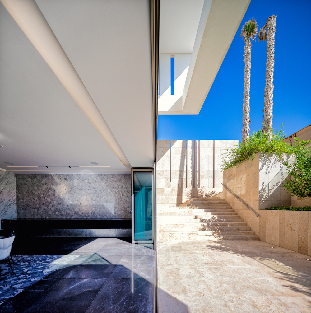 From the outdoor steps is the large open wall of the indoor pool.