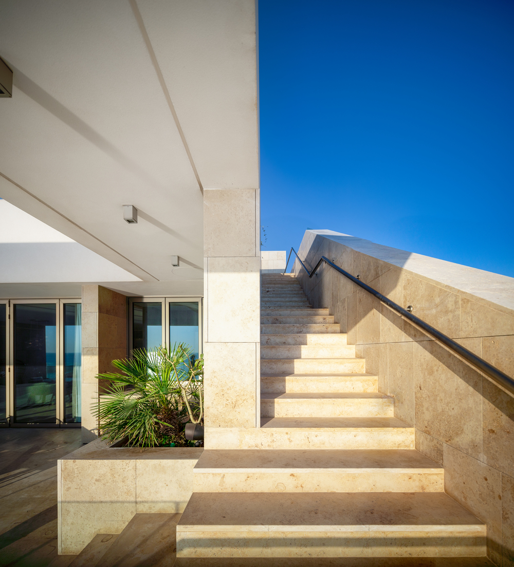 This is a close look at the brown marble steps leading to the terrace above.