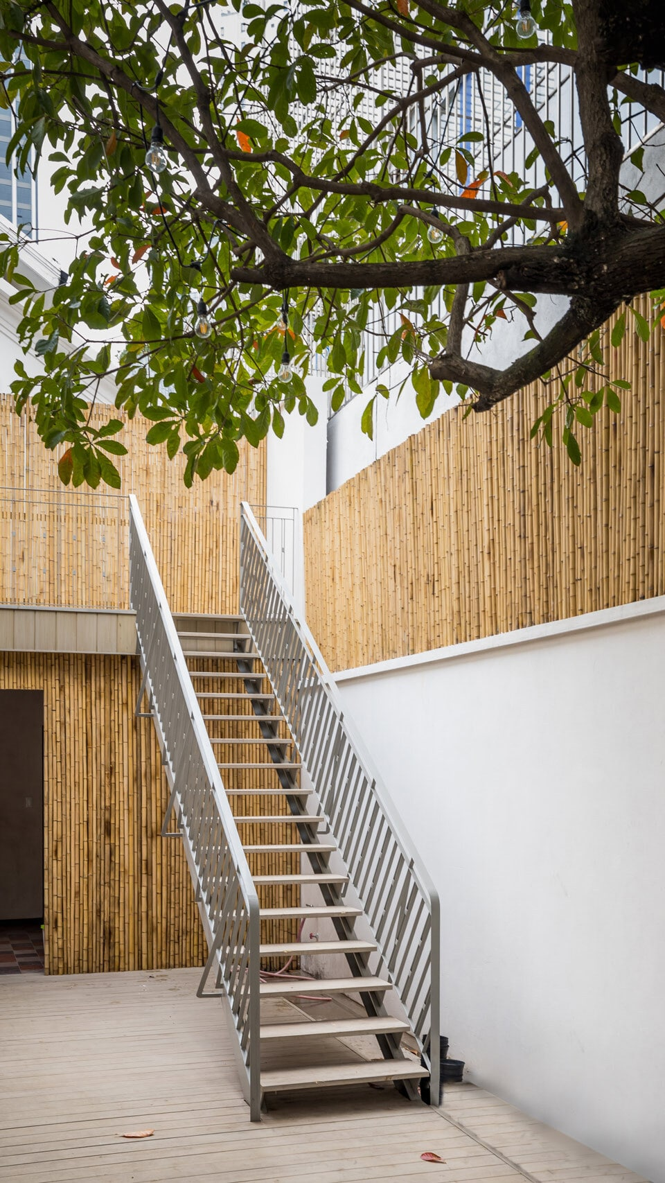 This is a look at the outdoor staircase of the house fitted with bamboo accents on the walls.