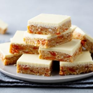 A stack of apricot oatmeal bars on a plate.