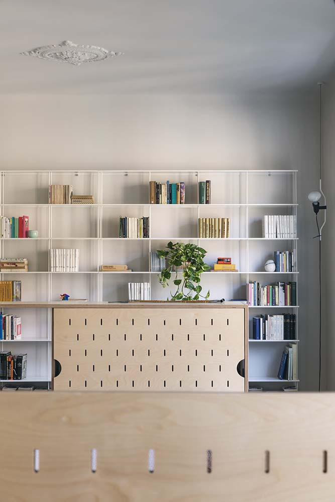 This is a close look at the house's miniature library with a large bookshelf and a reading nook.