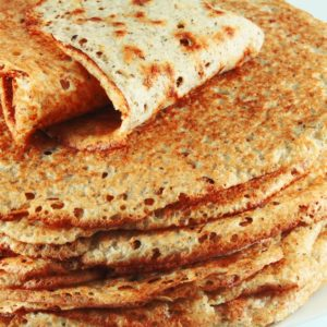 A close look at a stack of buckwheat pancakes.