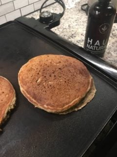 The pancake is flipped to cook the other side.