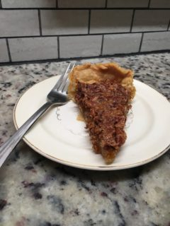 A slice of classic pecan pie.