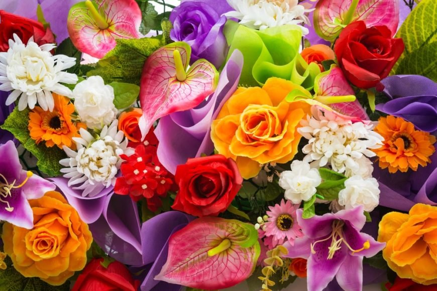 This is a close look at a bunch of various colorful flowers.