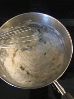 Flour, milk and water are mixed in a saucepan.
