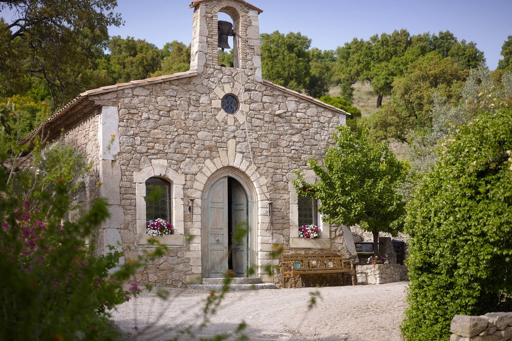 This is a close look at the guest house that used to be the village church with rustic mosaic stone exterior walls. Image courtesy of Toptenrealestatedeals.com.