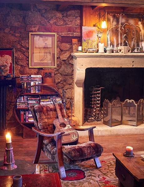 This is a close look at the rustic living room of the main house with a mosaic stone wall and a large fireplace. Image courtesy of Toptenrealestatedeals.com.