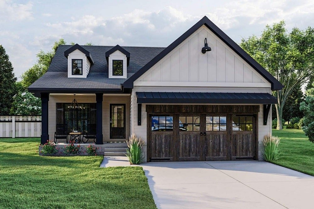 This is a front view of a craftsman farmhouse-style home with double garage and dark wooden tones as accent on the doors topped with dormer windows.