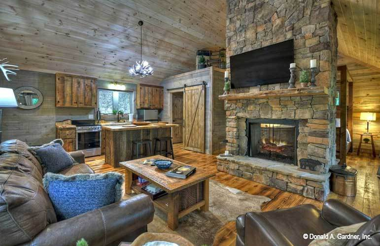 The stone fireplace sets a nice focal point to the open living space.