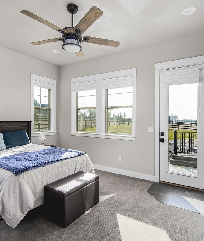 This bedroom has carpet flooring, a ceiling fan, and outdoor access.