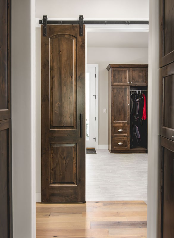A sliding barn door opens to the primary closet.