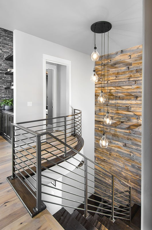 There's a glass cascading chandelier suspended above the staircase.