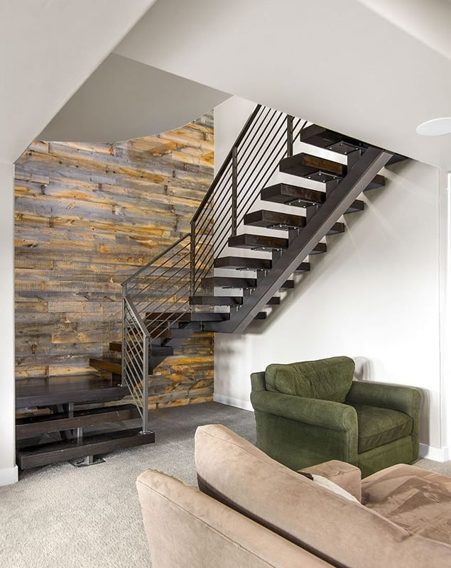 The basement has carpet flooring and wood-paneled accent wall.