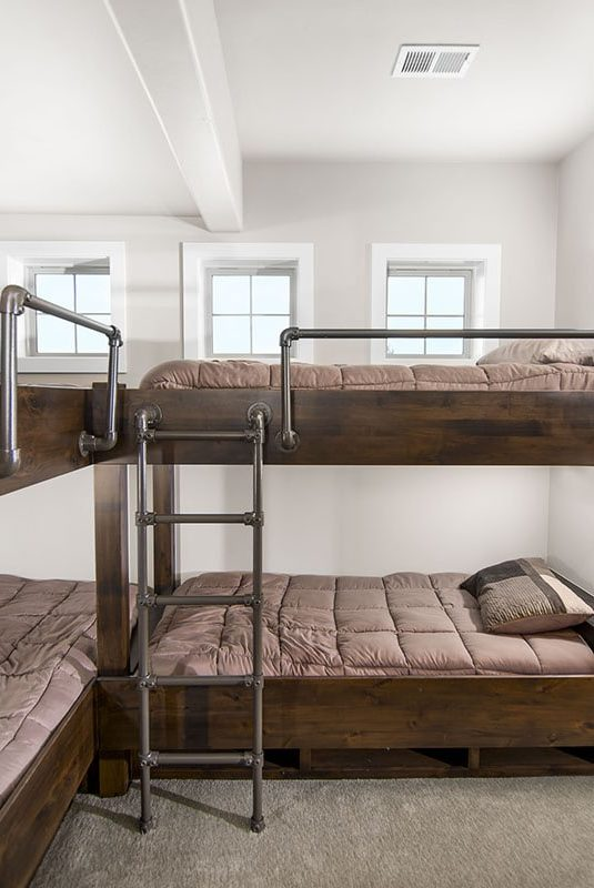 This bedroom offers built-in bunk rooms for guests.