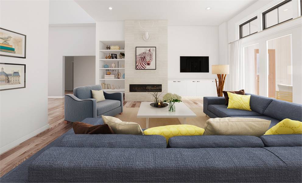 This is a close look at a Northwest-style living room with a white coffee table surrounded by gray sofas across from the modern fireplace beside the wall-mounted TV and the built-in shelf.