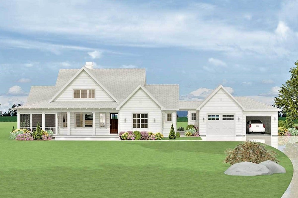 This is a front view of this farmhouse-style home with a consistent beige tone to its exterior walls with a semi-attached garage of the same tone.