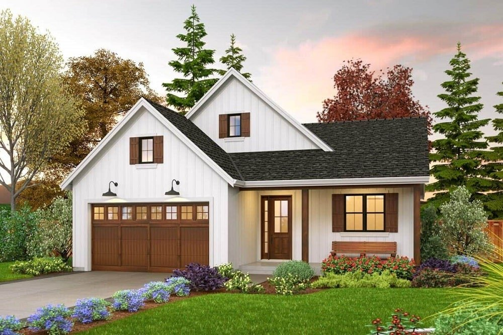 This is a front look at the farmhouse-style home exterior with a dark brown garage door that matches with the tone of the main door and window frames.