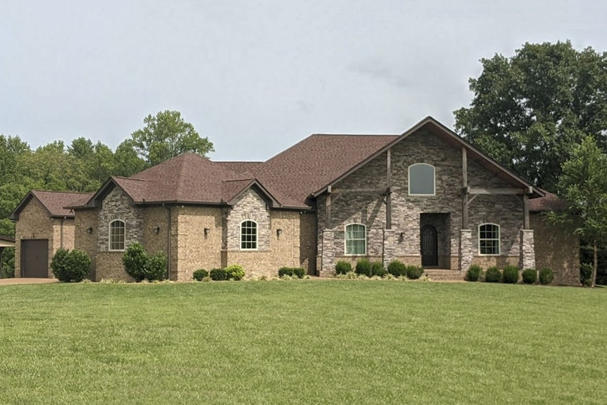 Single-Story 3-Bedroom Multi-Generational Hill Country Home with Angled 3-Car Garage