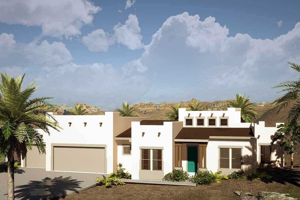 This is a Santa Fe style Adobe home with a large garage door on the left and dark brown accents to its bright beige exterior walls.