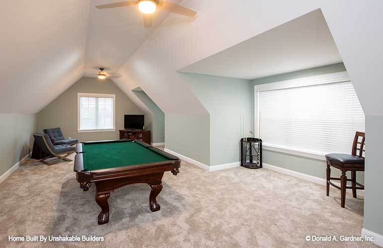 Bonus room with a vaulted ceiling and a billiards table over carpet flooring.