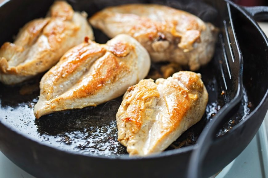 A close look at a batch of skillet parmesan chicken freshly cooked.