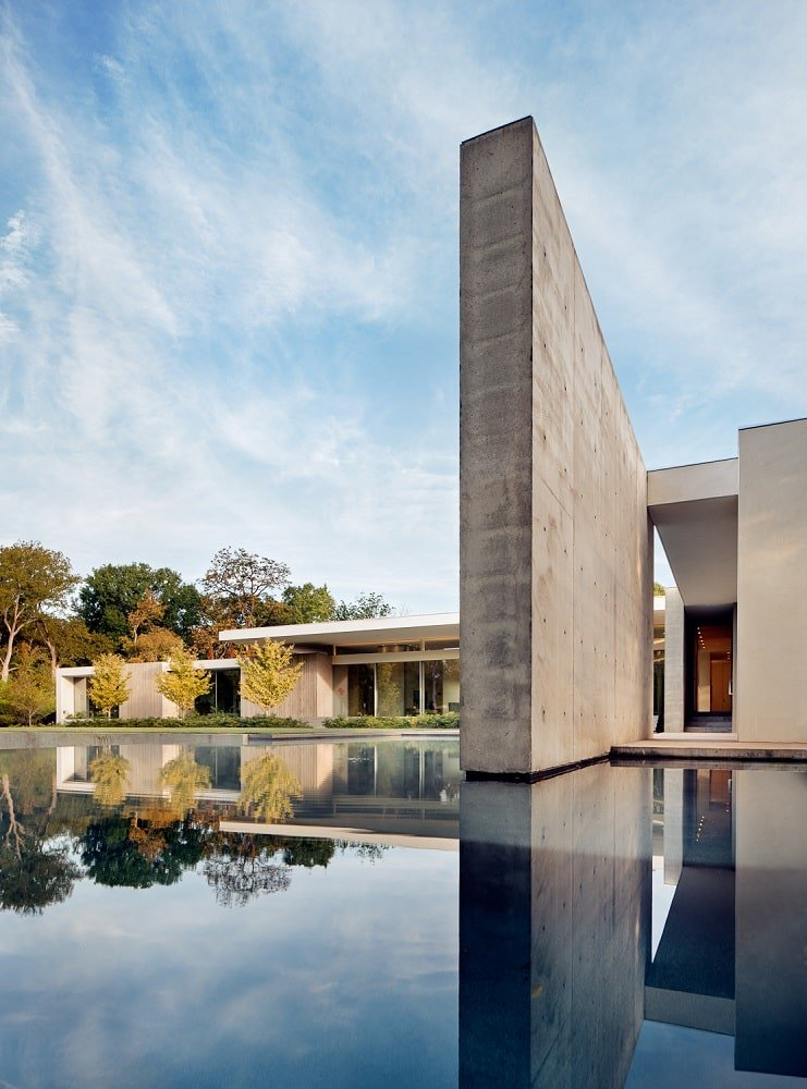 This is a close look at the pool with a unique design that complements the concrete structures of the house.