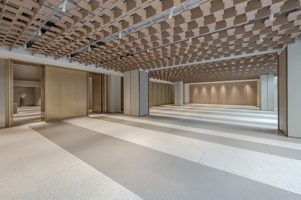 The large space is topped with a patterned wooden paneled ceiling that gives it an intricate design.