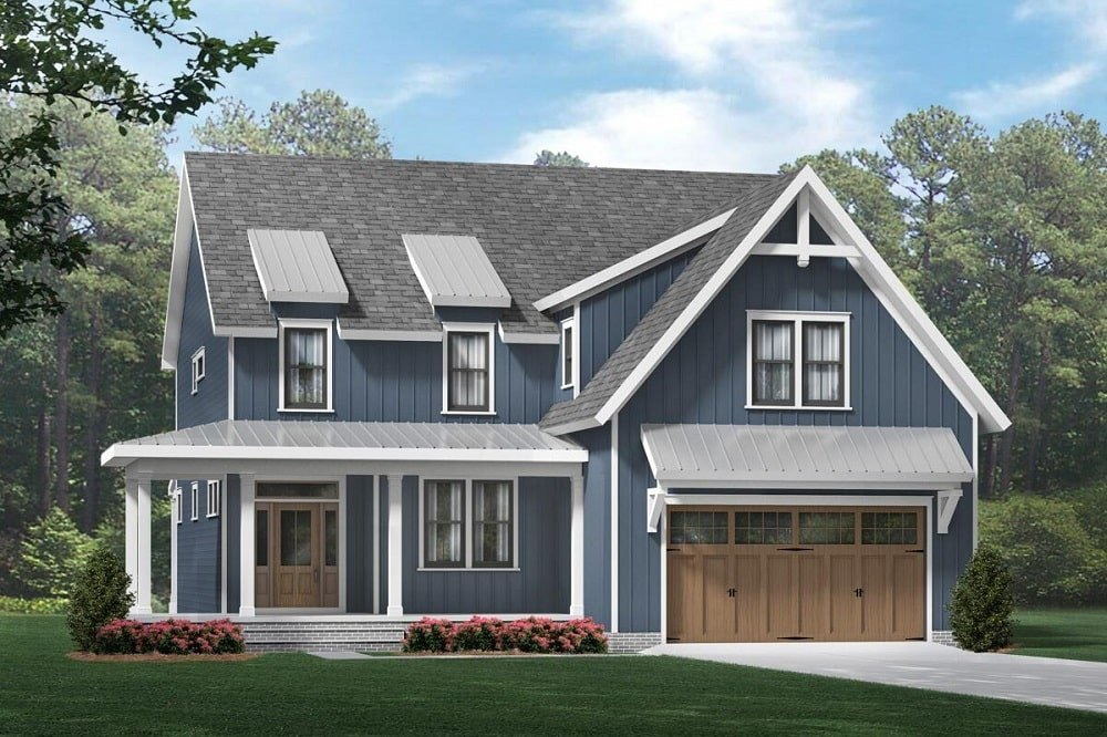 This is a three-story farmhouse-style home with a gray tone to its exterior walls accented with light gray tones on its roof and frames.