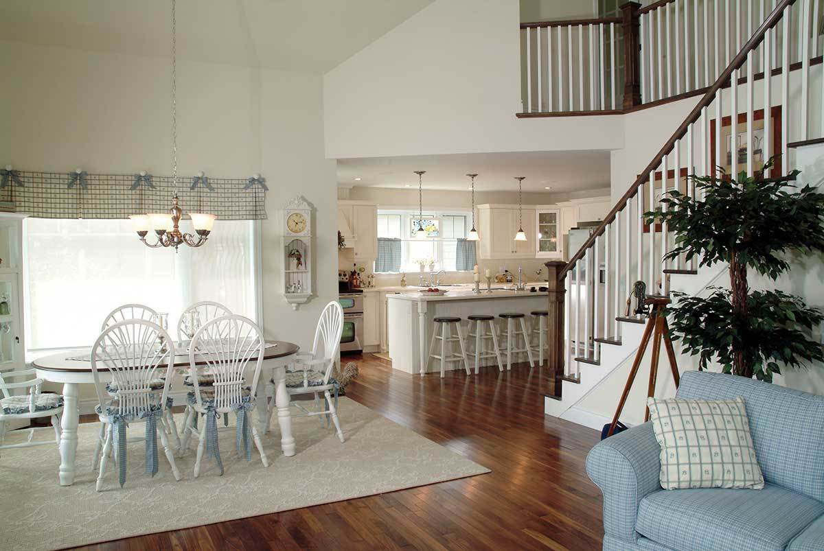 The dining area with an oval dining set sits in between the kitchen and living room.