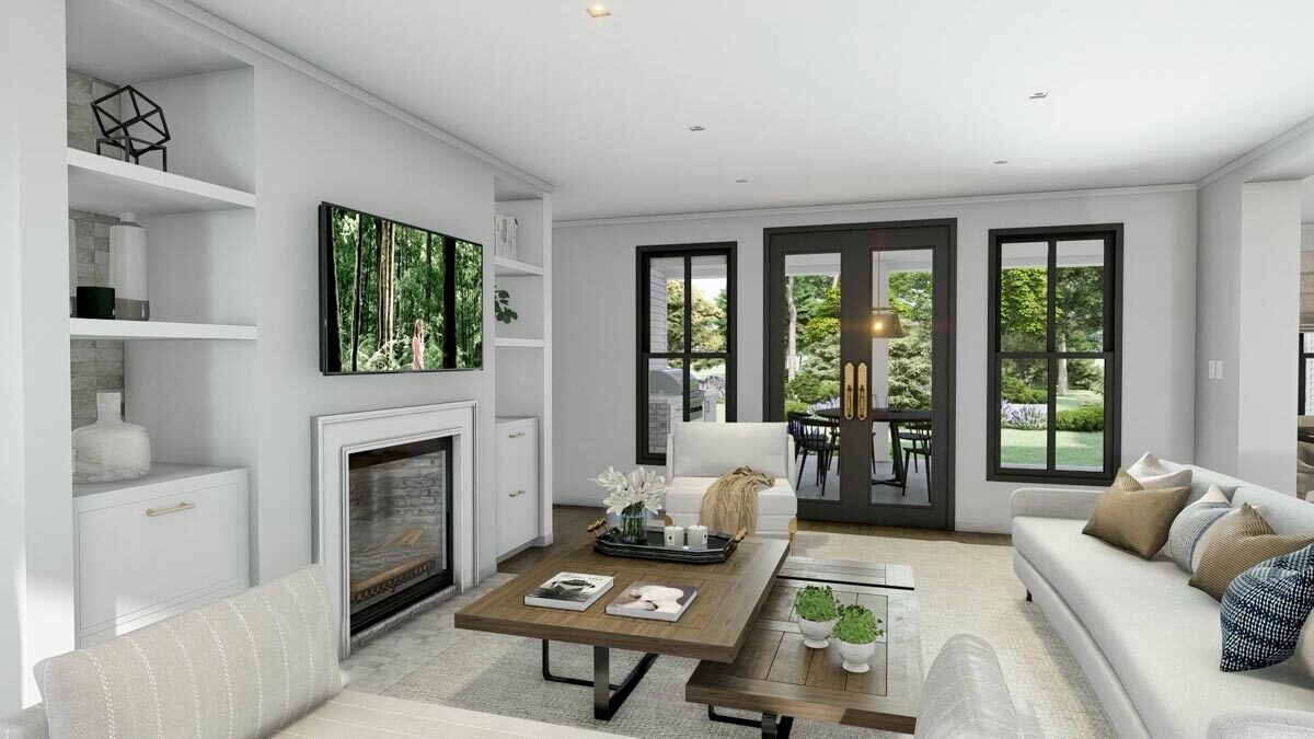 Living room with gray seats, a modular coffee table, and a fireplace flanked by white built-ins.