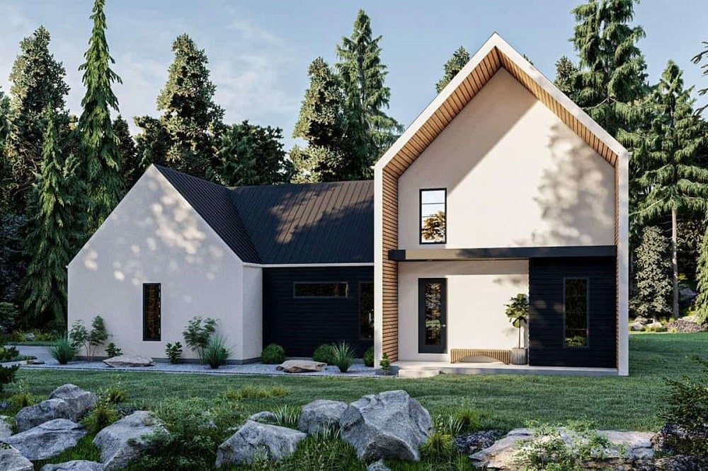 This is a look at the back exterior of this ultra-modern farmhouse-style home with a Ushape and dark matte tones on its roof and exterior wall to contrast the beige exterior walls.