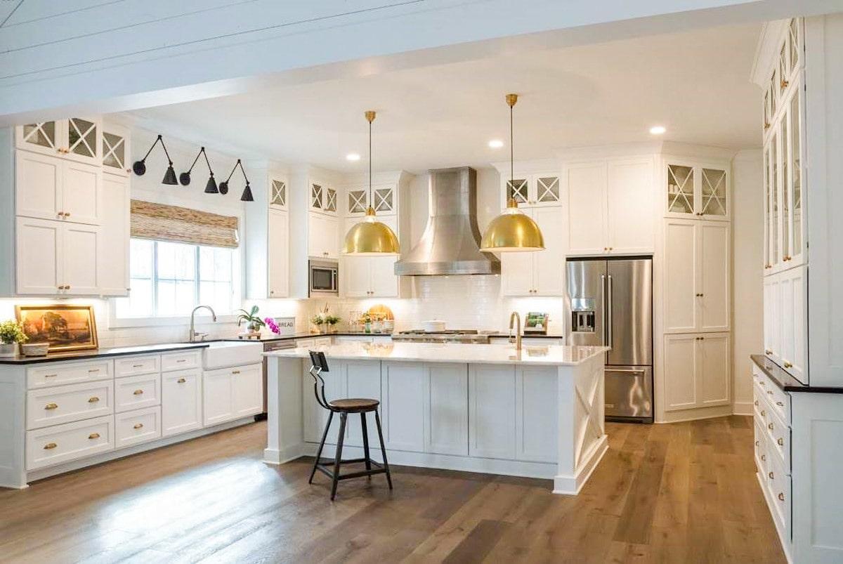 A couple of brass dome pendants illuminate the kitchen island.