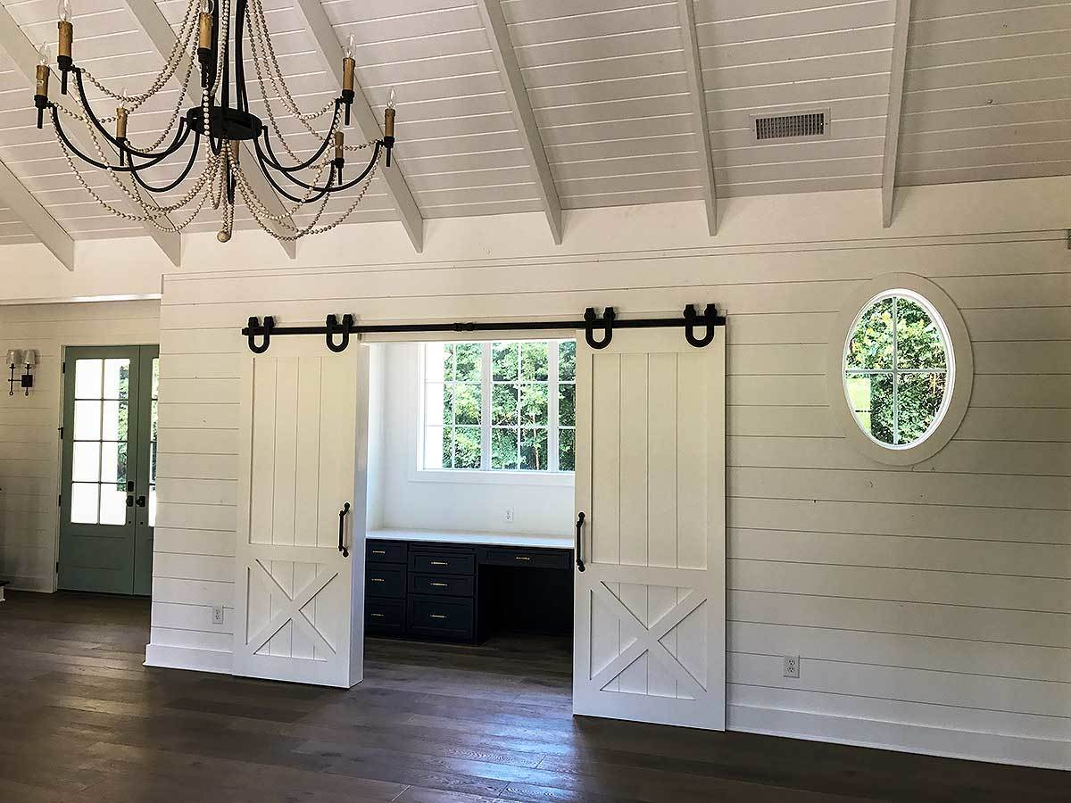 Double sliding barn doors open to the home office.