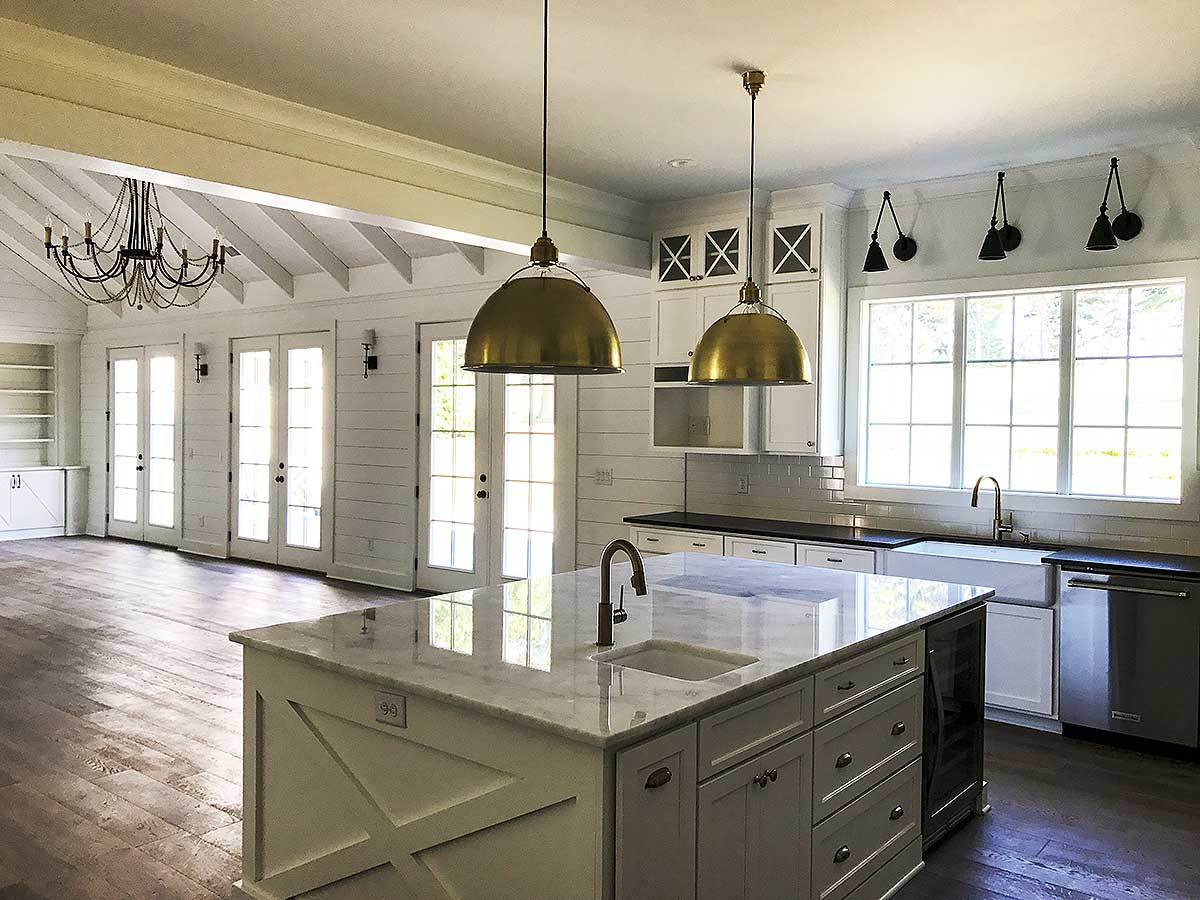 The center island is complemented with a sink and a couple of brass pendants.