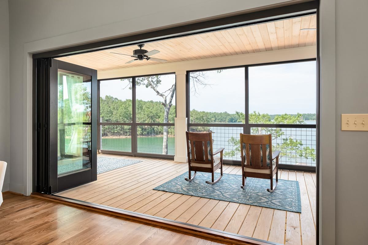 The foldable doors open to the wraparound covered porch.
