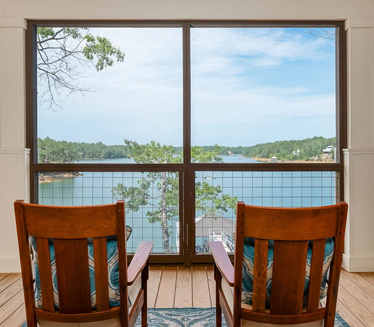 Here, you have wooden rocking chairs and a breathtaking view of the lake.
