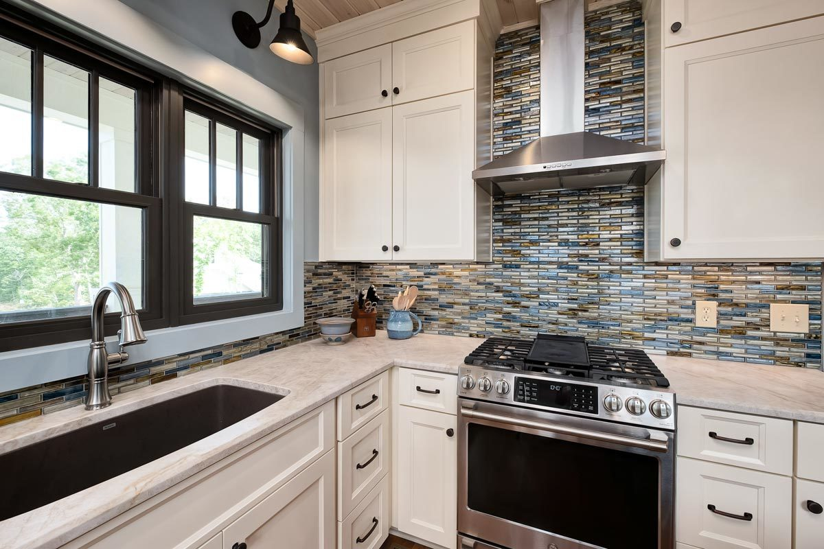 The linear mosaic tile backsplash creates a stunning accent to the kitchen.