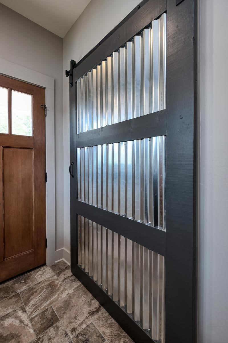 A closer look at the oversized barn door fitted with a corrugated panel.
