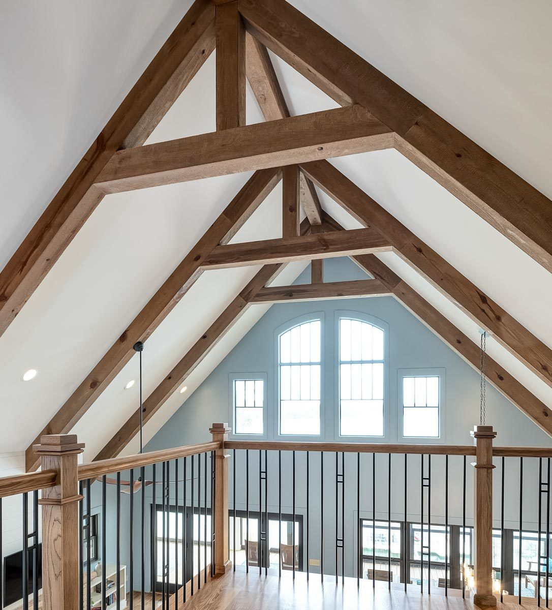 Exposed trusses lining the cathedral ceiling add a character to the interior.