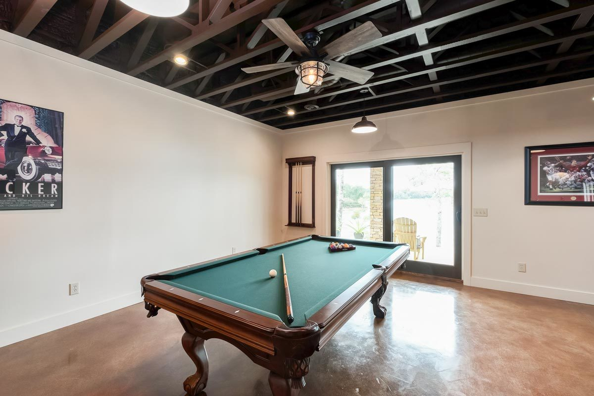 Game area with a billiards table and patio access.
