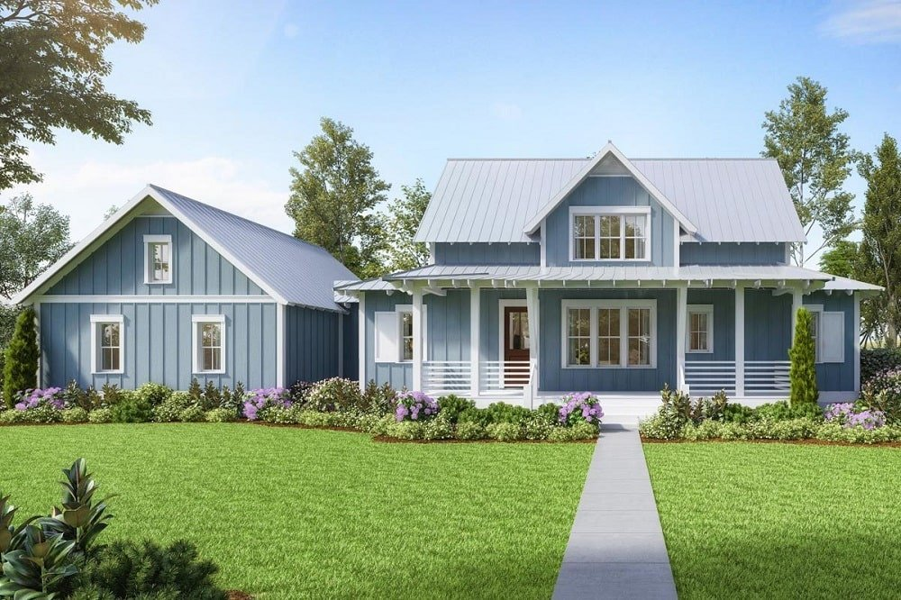 This two-story farmhouse-style home with multiple windows and matching glass door that stands out against the light gray exterior walls.